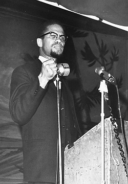 Malcolm X speaking at the Audubon Ballroom in Harlem on Feb. 15, 1965. Six days later, he was assassinated as he was about to speak again.